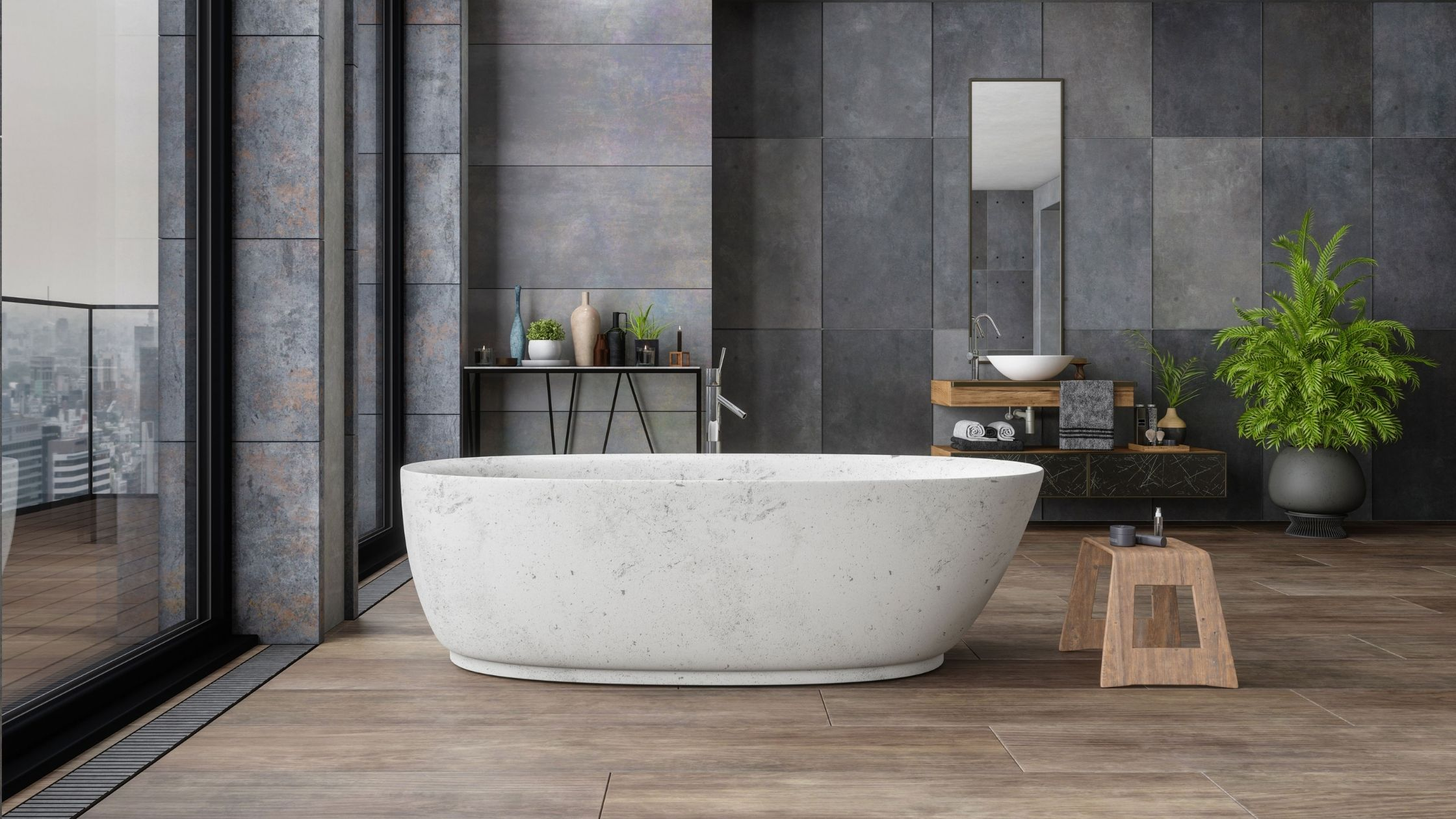 Washroom, wooden floor and and dark stone wall tiles, white ceramic bath